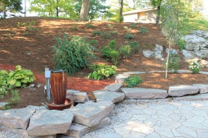 Mocha Limestone walls and Mega Arbel pavers